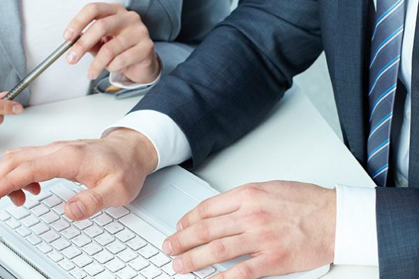 Group of business people working with laptop at meeting
